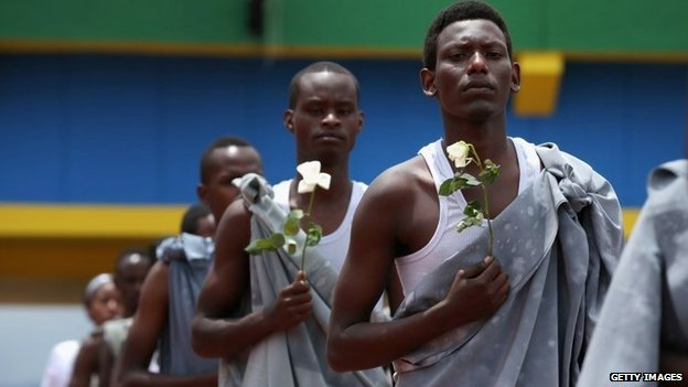 Performers enter Amahoro Stadium during the commemoration of the 20th anniversary of the 1994 genocide April 7, 2014 in Kigali, Rwanda.
