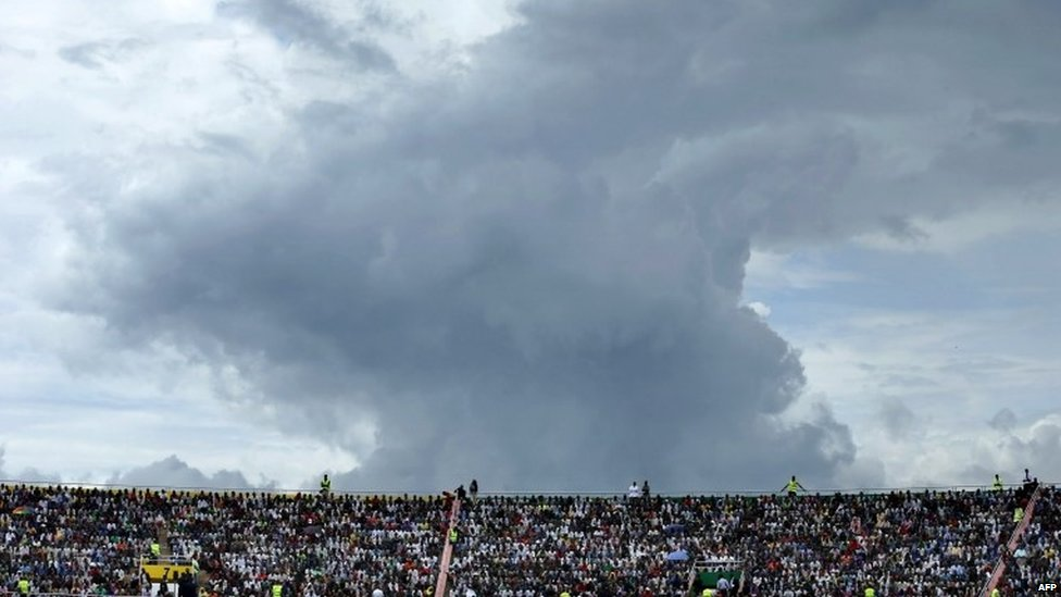 The sky threatens rain as tens of thousands of people gather to commemorate the 20th anniversary the 1994 genocide at Amahoro Stadium on 7 April 2014 in Kigali, Rwanda