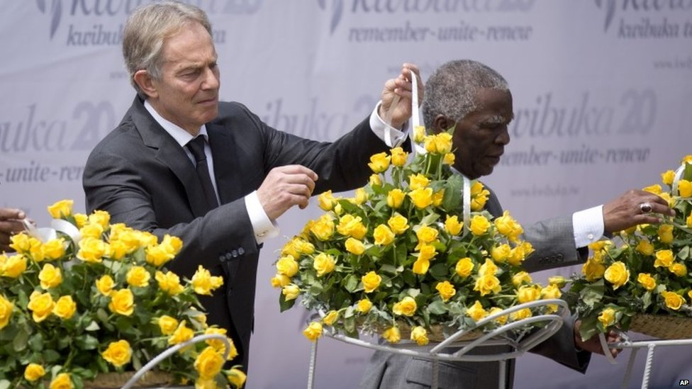 Tony Blair, left, and Thabo Mbeki, right, lay a memorial wreath at a ceremony to mark the 20th anniversary of the Rwandan genocide in Kigali on 7 April 2014