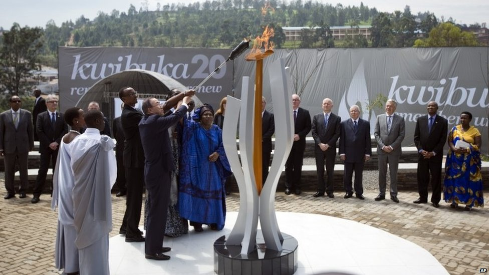 Rwandan President Paul Kagame and UN Secretary-General Ban Ki-moon light a memorial flame at a ceremony to mark the 20th anniversary of the Rwandan genocide, held in Kigali on 7 April 2014