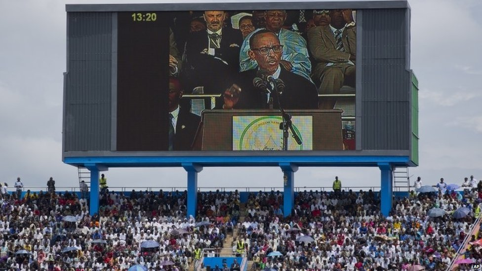 Rwandan President Paul Kagame, seen on a large television screen, addresses the public and dignitaries at a ceremony to mark the 20th anniversary of the Rwandan genocide, at Amahoro stadium in Kigali on 7 April 2014