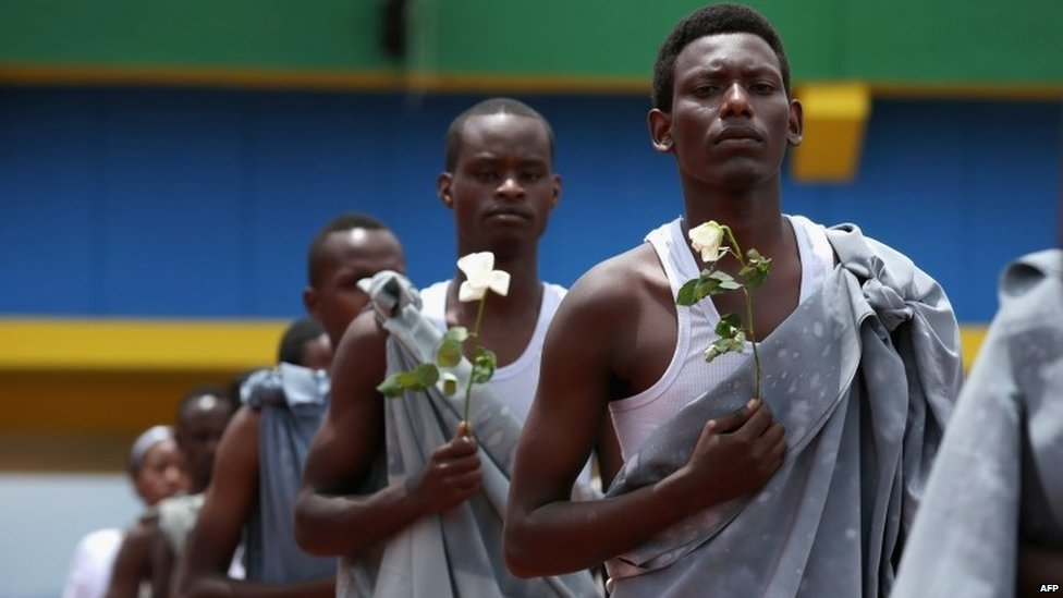 Performers enter Amahoro Stadium in Kigali, Rwanda, during the commemoration of the 20th anniversary of the 1994 genocide (7 April 2014)