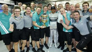 Lewis Hamilton (centre) celebrates after winning the Bahrain GP