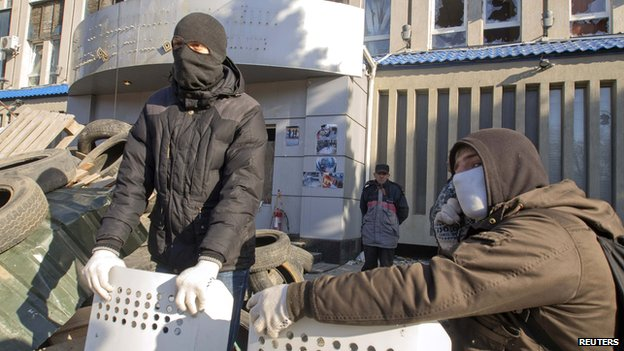 Pro-Russia protesters gather at a barricade outside the offices of the SBU state security service in Luhansk, in eastern Ukraine