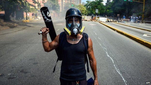A demonstrator takes part in a protest against Venezuelan President Nicolas Maduro in Caracas on 6 April, 2014