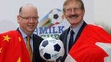 Dale Farm's Stephen Cameron and tournament chairman Victor Leonard celebrate confirmation that China and Canada will compete in the Milk Cup