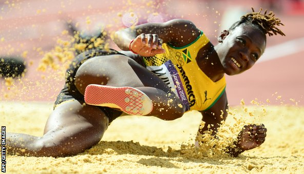Jamaica's Kimberly Williams competes in the women's triple jump qualifying rounds at the athletics event during the London 2012 Olympic Games on August 3, 2012 in London.