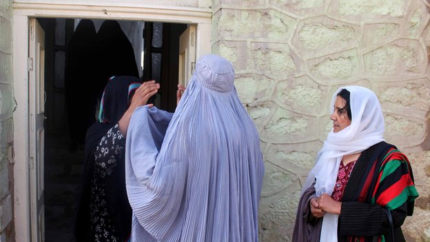 Female security staff were on hand to check female voters at a polling centre in Kandahar