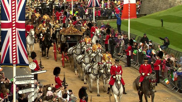 Royal carriage passes through Windsor on the way to the castle