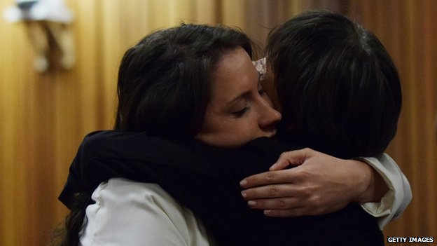 Aimee Pistorius hugs a family member in the Pretoria High Court, 8 April