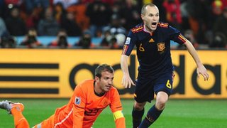 Andres Iniesta scores for Spain as Rafael van der Vaart of Netherlands looks on