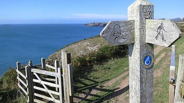 Path sign and path towards St Justinians, Pembrokeshire