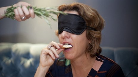 Woman eating blindfolded