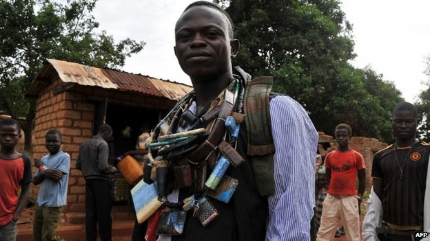 An anti-Balaka militiaman, wearing several charm necklaces, in CAR on 5 March 2014