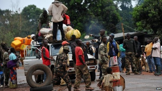 Members of the anti-Balaka Christian militia search a vehicle at a checkpoint in Pissa, CAR on 3 March 2014