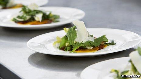 Four plates of salad