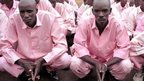 Prisoners in Rwanda pictured on 2 December 2003 waiting to be transferred to attend a gacaca court session in relation with the 1994 genocide.