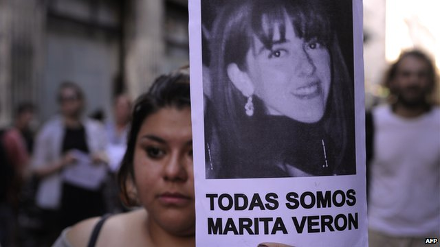 A woman holds a picture of Marita Veron near the Casa de Tucuman in Buenos Aires, on December 12, 2012