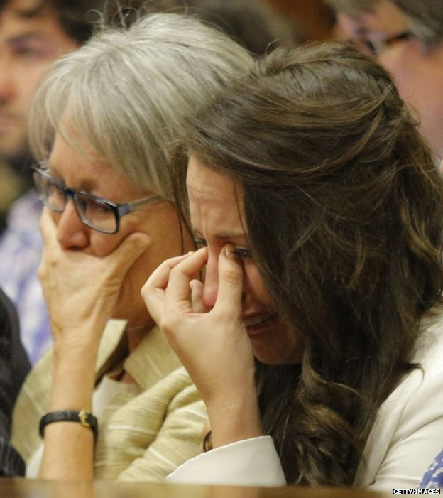 Aimee Pistorius is overcome with emotion as she listens to her brother Oscar's testimony in the Pretoria High Court, 8 April