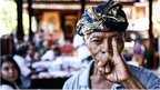 A man shows his ink-stained finger after casting his ballot during legislative elections on 9 April, 2014 in Denpasar, Bali, Indonesia