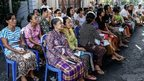 Voters wait at a polling station during legislative elections on 9 April, 2014 in Denpasar, Bali, Indonesia