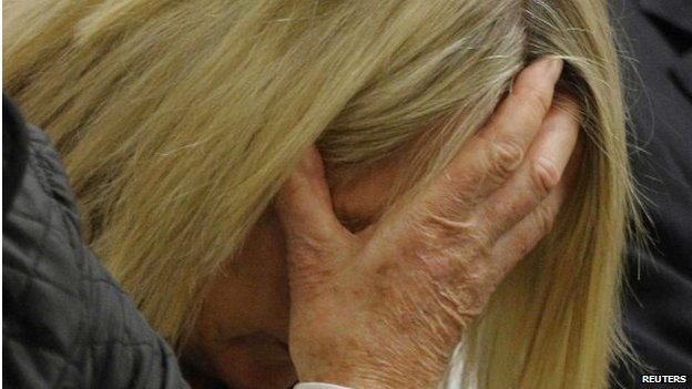 June Steenkamp, mother of Reeva Steenkamp, holds her head as Oscar Pistorius gives evidence in Pretoria, 8 April