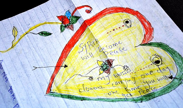 A colourful heart has been drawn on a piece of paper