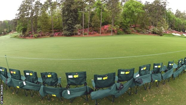 Patrons arrange chairs around Amen Corner during the second round of the 2013 Masters
