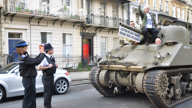 A PCSO taking a photograph of the tank