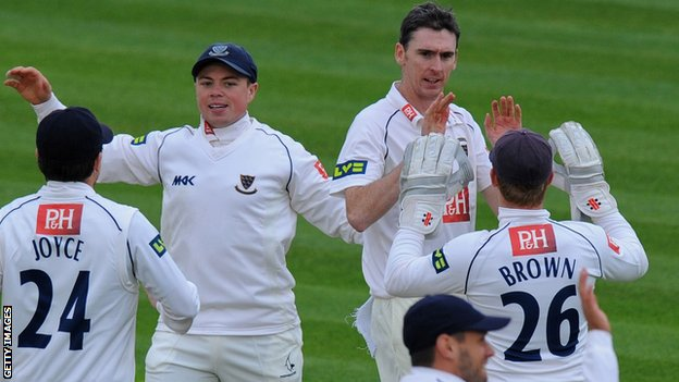 Steve Magoffin celebrates with his Sussex team-mates
