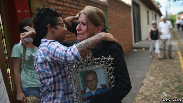 Carmen Gonzalez hugs a student protester following a mass for her son Jimmy Vargas on 7 March, 2014