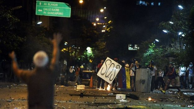 Anti-government protestors are seen during clashes with members of the National Guard in Caracas on 29 March, 2014