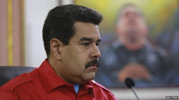 Venezuela's President Nicolas Maduro pauses during a meeting on social movements at Miraflores Palace in Caracas on 7 April, 2014