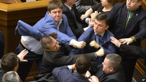 Ukrainian politicians fight during a parliament session in Kiev - 8 April 2014