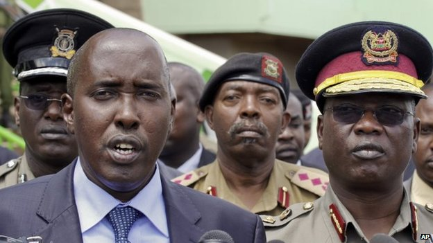 Joseph Ole Lenku (L) with police officials
