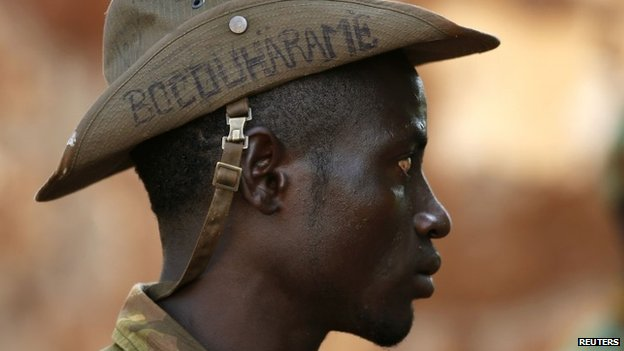 "A Seleka fighter wears a hat that reads ""Bocou Harame"" in the town of Bria (April 2014)"
