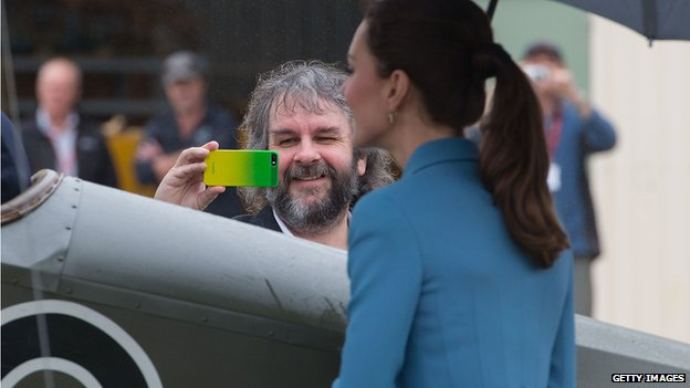 Peter Jackson takes a picture of Catherine as she inspects a plane