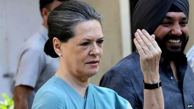 Congress Party President and chairperson of India's UPA government Sonia Gandhi shows her marked finger after casting her vote at a polling centre in New Delhi on April 10, 2014