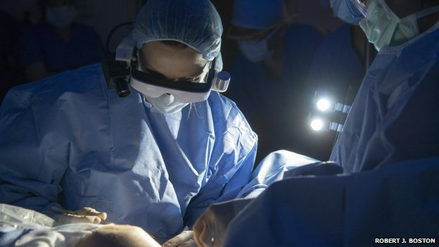 Surgeon wearing goggles during operation