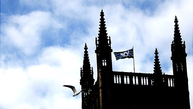 Worcestershire flag flying from cathedral with seagull flying by