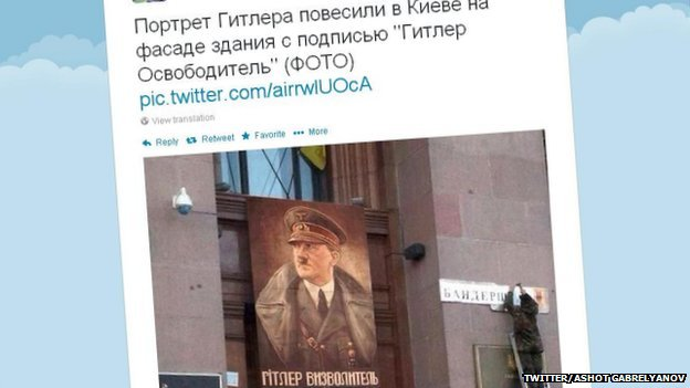 Tweet of doctored photo showing an image of Adolf Hitler hanging on an official building in Kiev
