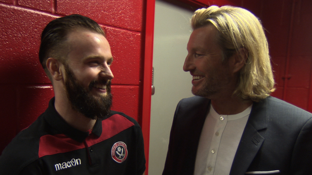 Robbie Savage speaks to Sheffield United's John Brayford