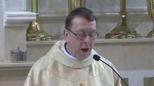 Singing Priest