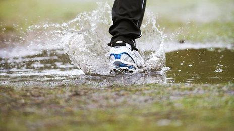 Man running through a puddle