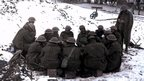 A group of soldiers sitting on the snow