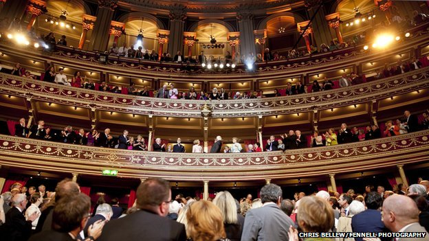 Mr Higgins and his wife were applauded as they entered the Royal Albert Hall