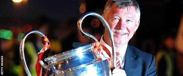 Six Alex Ferguson pictured with the Champions League trophy after United won it in 2008