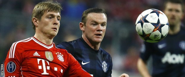 Bayern Munich's Tony Kroos vies with Manchester United's Wayne Rooney