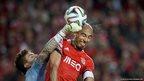 Benfica's Brazilian defender Luisao vies with Rio Ave's Brazilian goalkeeper Ederson Moraes