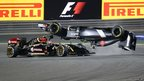 Sauber driver Esteban Gutierrez of Mexico crashes ahead of Lotus driver Pastor Maldonado of Venezuela during the Formula One Bahrain Grand Prix at Sakhir circuit in Manama